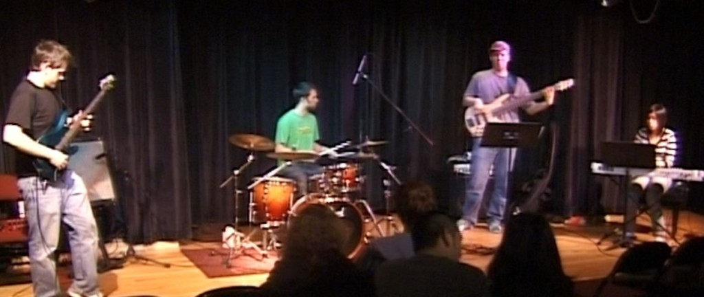 Charlie (on the left) during his Berklee days, doing what Performance majors to best.